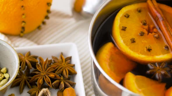 Thumbnail for Spices and Hot Mulled Wine with Orange Slices 34