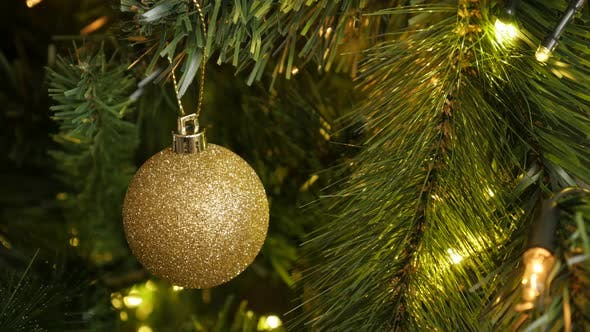 Thumbnail for Close-up of golden color  Christmas ornament 4K 2160p 30fps UltraHD footage - Sparkling  gold bauble