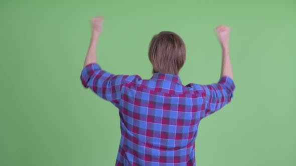 Cover Image for Rear View of Happy Young Hipster Man with Fists Raised