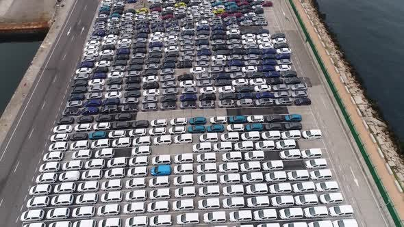 Thumbnail for Lot of New Unsold Cars on Pier