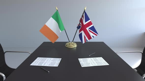 Flags of Ireland and United Kingdom and Papers on the Table