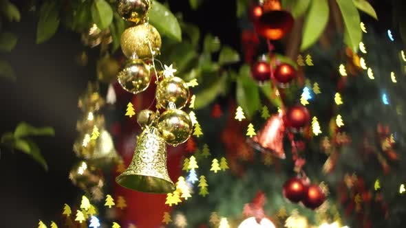 Bell and ball at christmas decoration at tree.