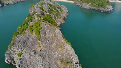 Aerial: clear blue sky at Cat Ba island and beach with new tourist resort, Halong bay Vietnam