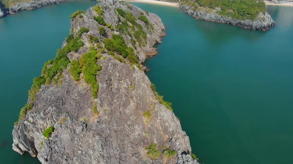 Thumbnail for Aerial: clear blue sky at Cat Ba island and beach with new tourist resort, Halong bay Vietnam
