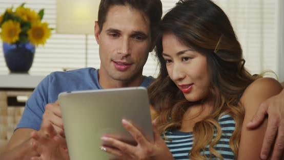 Thumbnail for Mixed race couple excited to make an online purchase