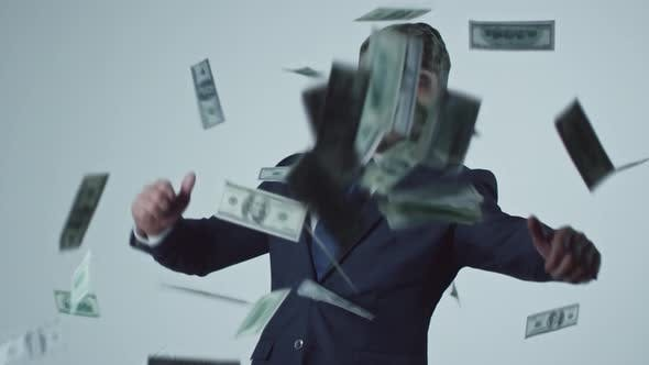 Thumbnail for Dollars Falling on Dancing Businessman
