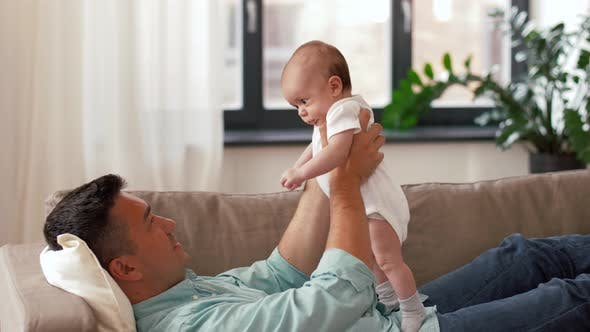 Thumbnail for Middle Aged Father with Baby Daughter at Home