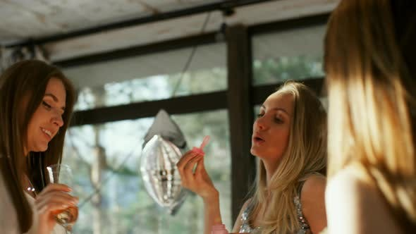 Thumbnail for Girlfriends Dancing and Blowing Soap Bubbles