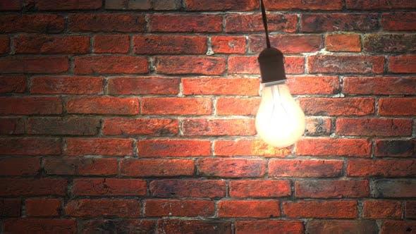 Cover Image for Incandescent Lamp Swinging in Dark Brickwall Room, Seamless Loop