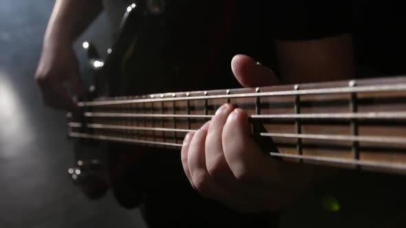 Thumbnail for Closeup. Chord on Guitar. Man Strums and Plays Electric Guitar