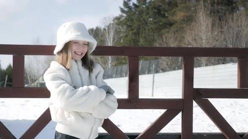 Adorable Smiling Girl in Fur Coat at Wintertime