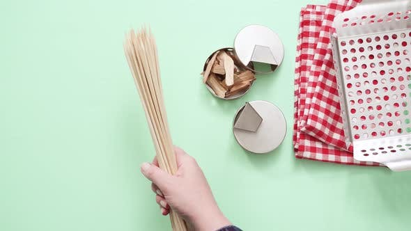 Thumbnail for Variety of grilling tools on blue background.