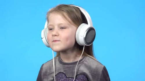 Little Girl Smiling, Listening To the Music, Nodding Her Head.