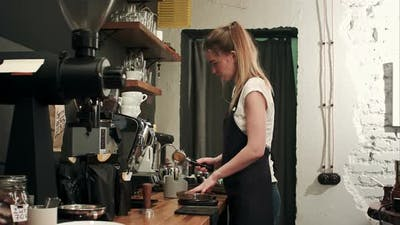 Barista Making Coffee with Proffessional Brewing Coffee Bar