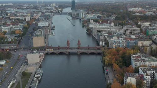 Oberbaum Bridge on Spree River in Berlin, Germany at Daytime, Aerial Dolly Truck Slide Right