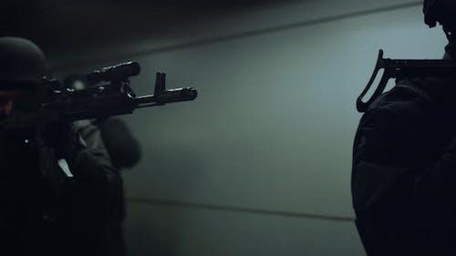 Antiterrorist Squad with Rifles Walking in Corridor