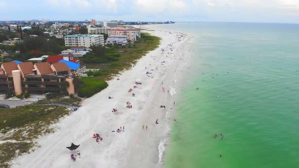Aerial Drone View Flight Over Miami Beach. Flight Over the Beach and People Relaxing in Cloudy