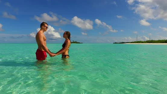 Thumbnail for Happy boy and girl on romantic honeymoon spend quality time on beach on white sand 4K background