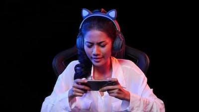 Gamer woman playing game