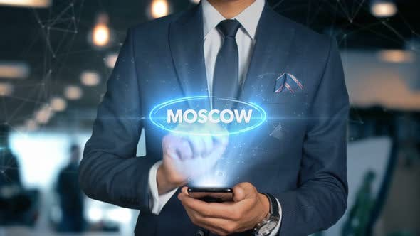 Businessman Smartphone Hologram Word Country   Capital   Moscow