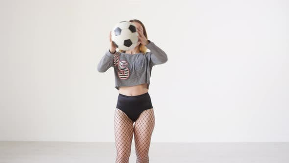Thumbnail for Dancehall Girl Smiling and Dancing with Soccer Ball in Studio