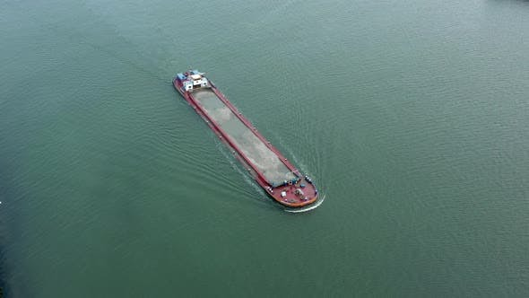 Aerial View of a Bulk Carrier Ship Moving Silt and Sand
