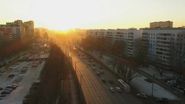 Thumbnail for Winter Road with Cars in the City Against the Bright Sun
