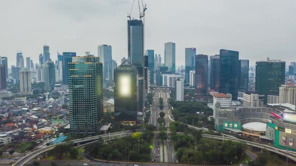 Thumbnail for Aerial Hyperlapse Time Lapse of a Busy Traffic in Modern City Center with Skyscrapers Towers and