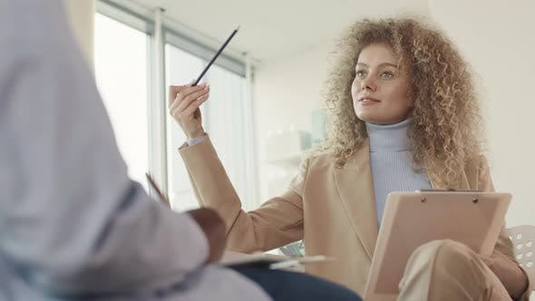 Thumbnail for Woman With Curly Hair In Office