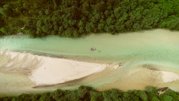Thumbnail for Aerial view of whitewater kayaker paddling on the Soca river, Slovenia.