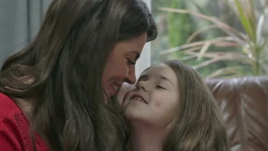 Cover Image for Portrait of Brunette Caucasian Woman and Little Girl Rubbing Noses