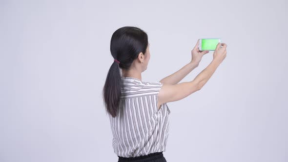 Thumbnail for Happy Beautiful Asian Businesswoman Taking Picture with Phone