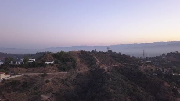 Thumbnail for AERIAL: Over Hollywood Hills at Sunrise with View on Hills and the Valley in Los Angeles View