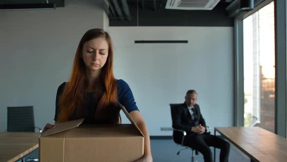 Thumbnail for Sad Employee Packing Her Belongings and Leaving the Office After Being Fired