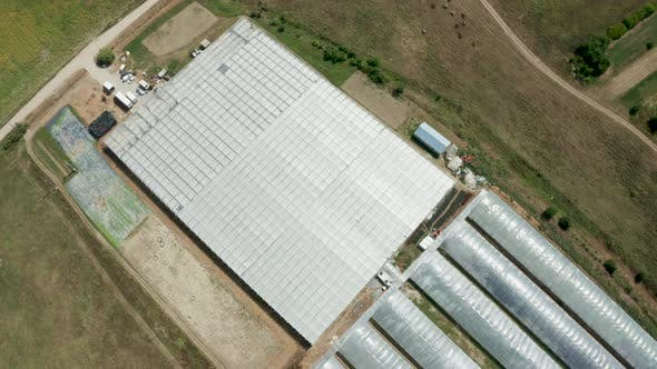 Thumbnail for Aerial View Flying Over an Industrial Greenhouse