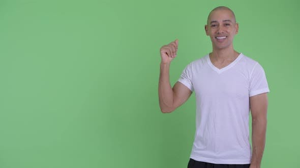 Thumbnail for Happy Handsome Bald Man Snapping Fingers and Presenting Something
