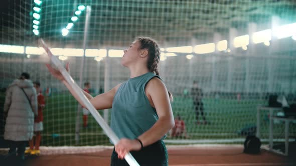 Thumbnail for Pole Vaulting - the Sportswoman Is Configuring To Jump and Starting To Run
