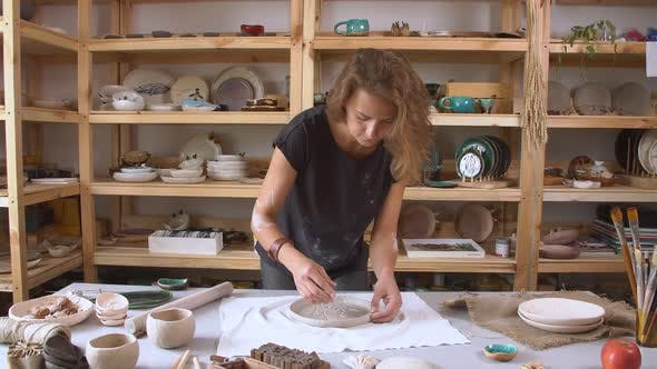 Thumbnail for Female Sculptor Working in the Studio To Create the Original Plates. Art and Handicraft Modelling