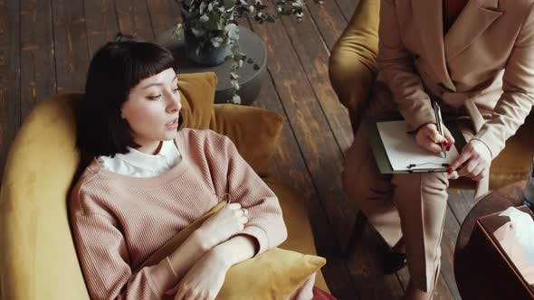 Thumbnail for High Angle of Depressed Woman Lying on Couch and Speaking with Counselor