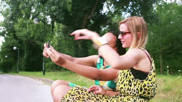 Thumbnail for Two young women having a great time taking selfies