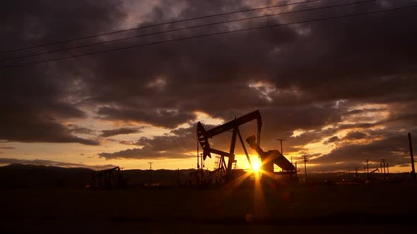 Thumbnail for Oil well piston pumps at sunset
