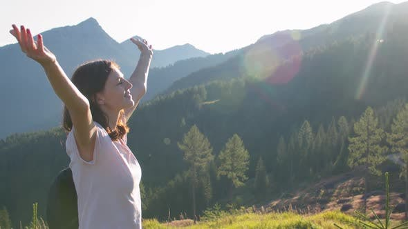 Woman Hiker with Raised Arms
