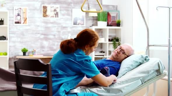 Thumbnail for Female Nurse Checking Old Sick Man Blood Pressure