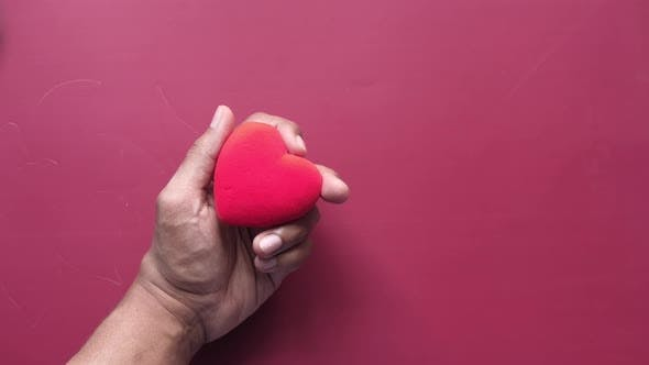 Thumbnail for Man Hand with Heart on White Background. the Concept of Take Care of Health