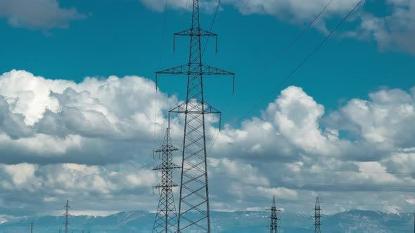 Cover Image for High Voltage Post Tower with Blue Cloudy Sky Background