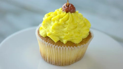 Cupcake with Delicious Yellow Cream