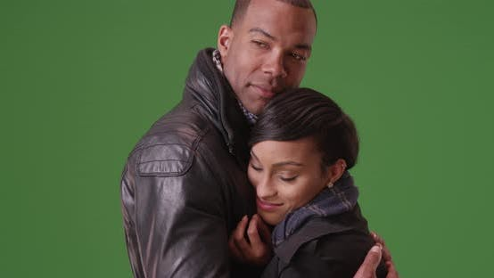 Thumbnail for A black couple embraces each other on green screen.