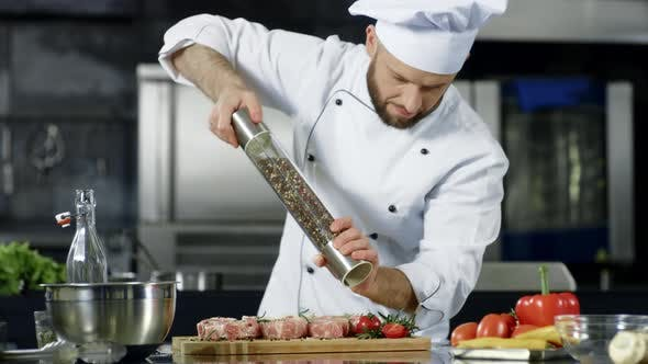 Thumbnail for Male Chef Cooking Meat at Professional Kitchen. Portrait of Chef Cooking Steak.