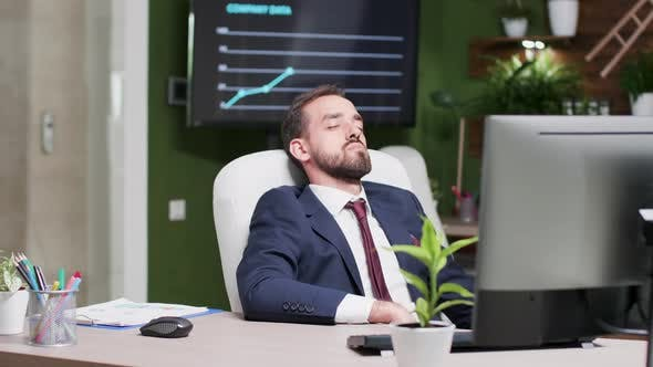Tired Businessman Fell Asleep at His Workplace