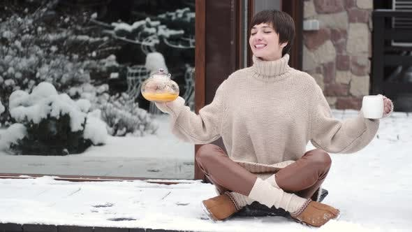 Peaceful Young Woman Drink Tea on Home Terrace in Winter